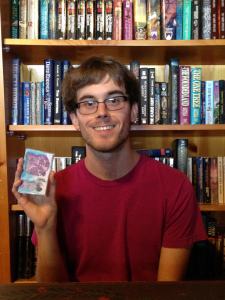"Garrett Crosby poses with a cassette of ""Goldleaf Acrobatics."""