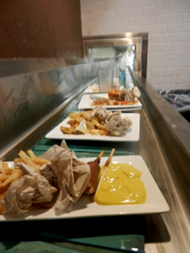 A sample of unwanted food on the cafeteria's conveyor belt.