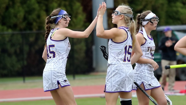 Lacrosse players high five after goal