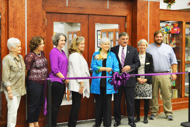 Pat Scales leads ribbon cutting