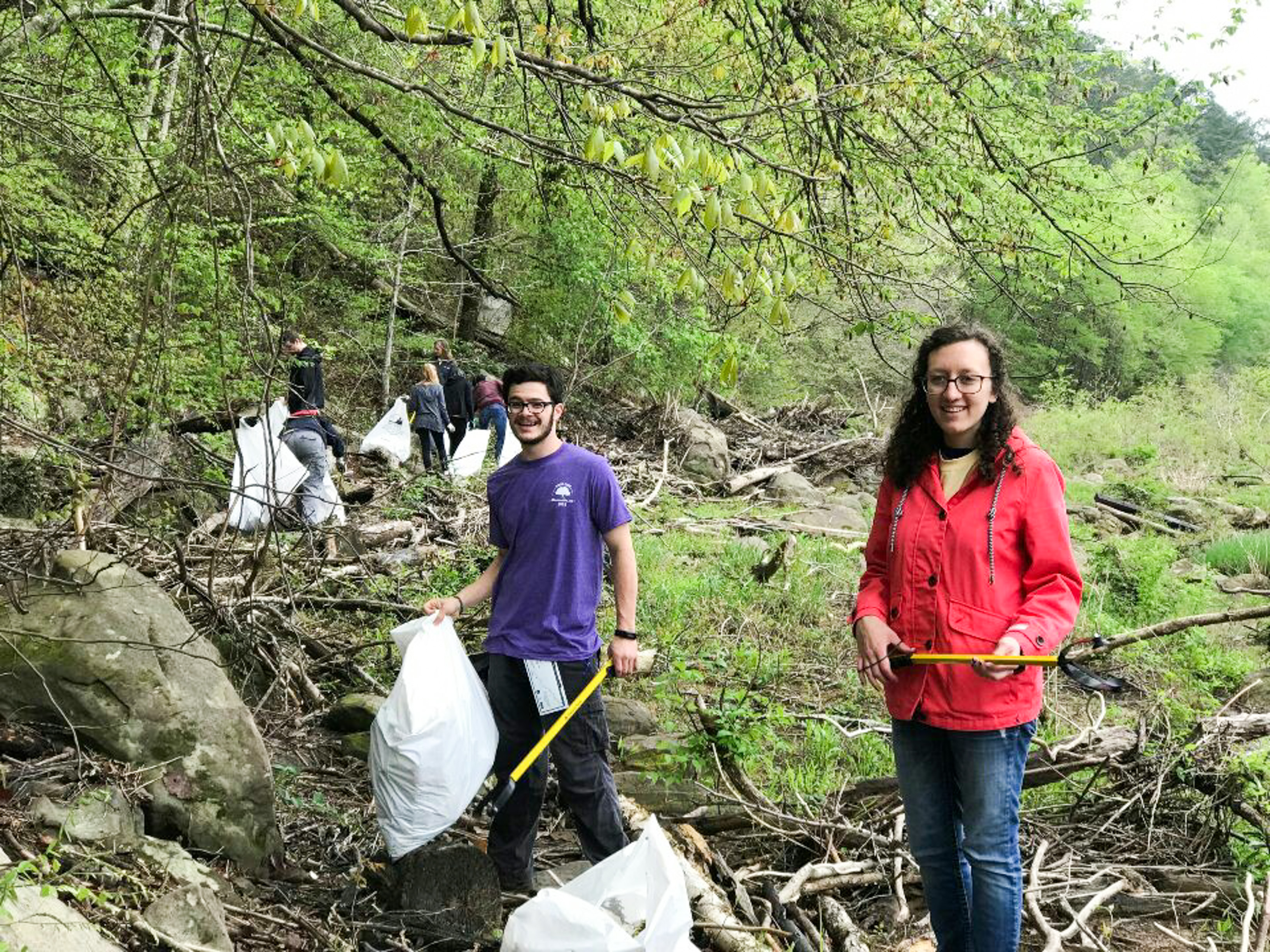 Environmental club members cleaning up the outdoors