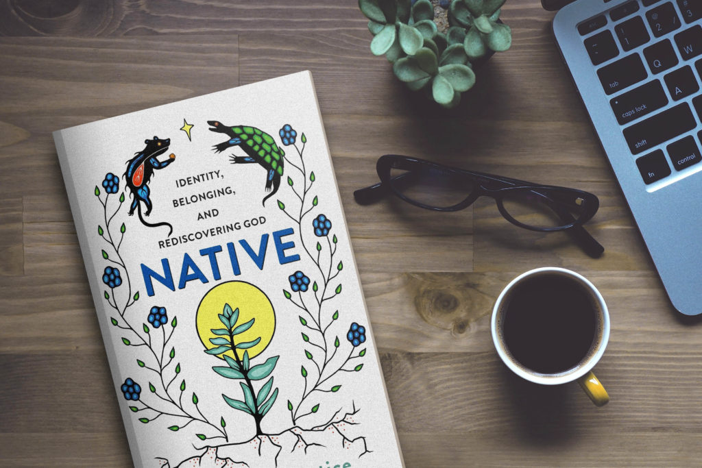 A copy of Native is sitting on a table next to a cup of coffee and an open laptop